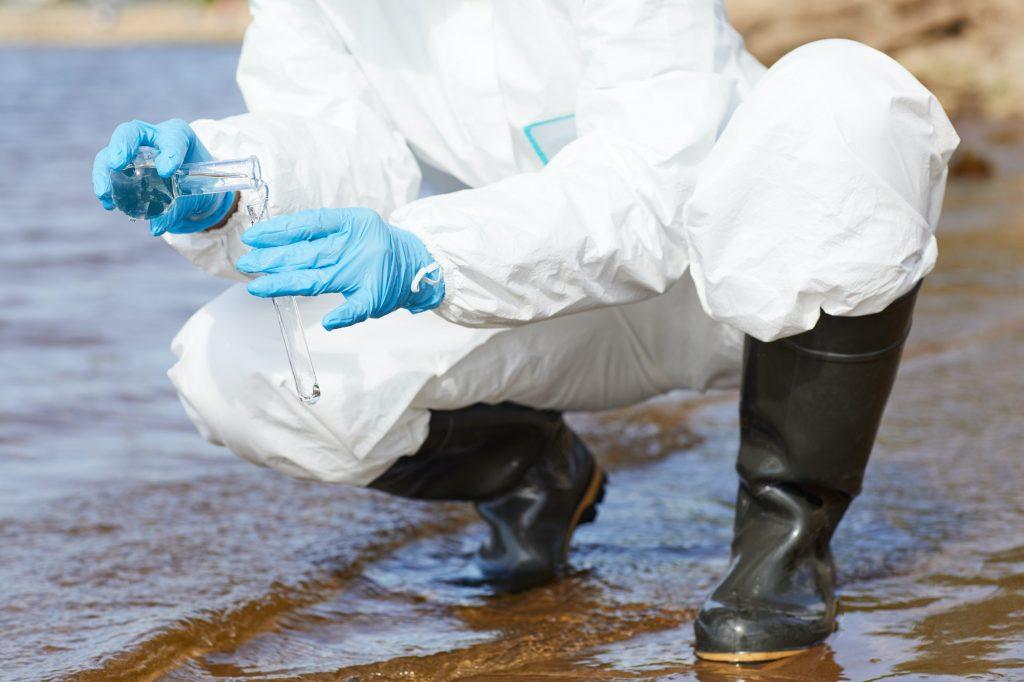 Chemist examining water
