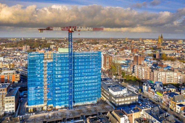 Construction crane building high rise apartment