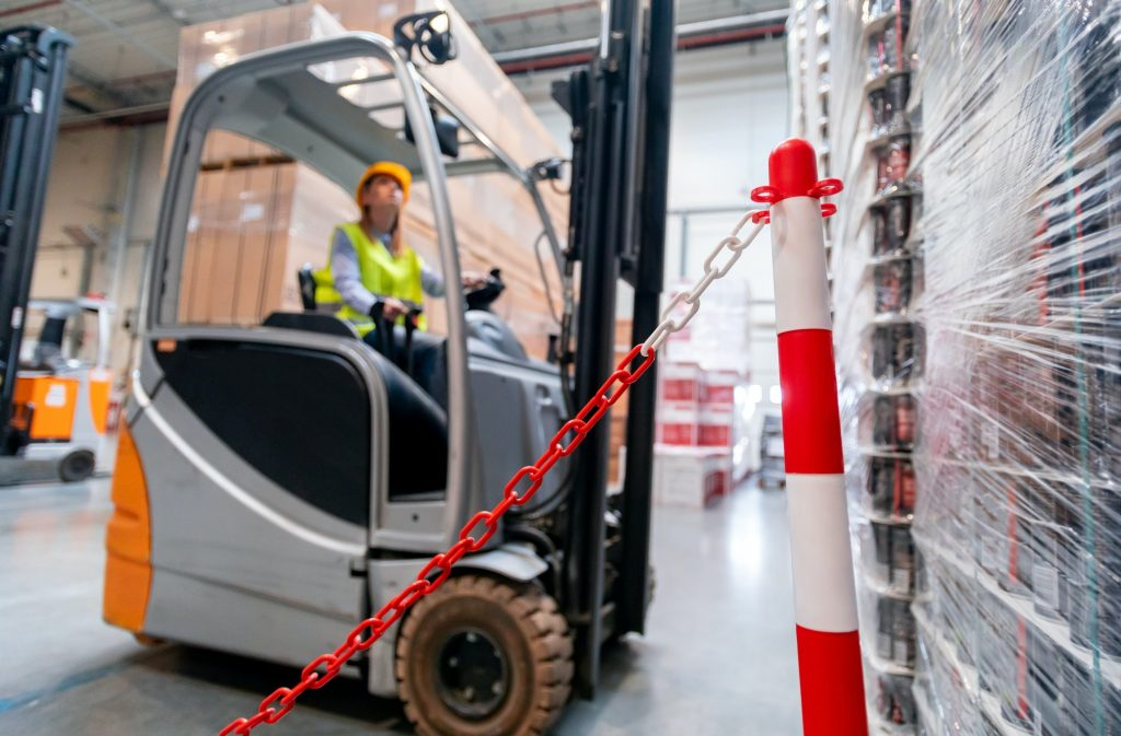 Safety at work with forklift in warehouse